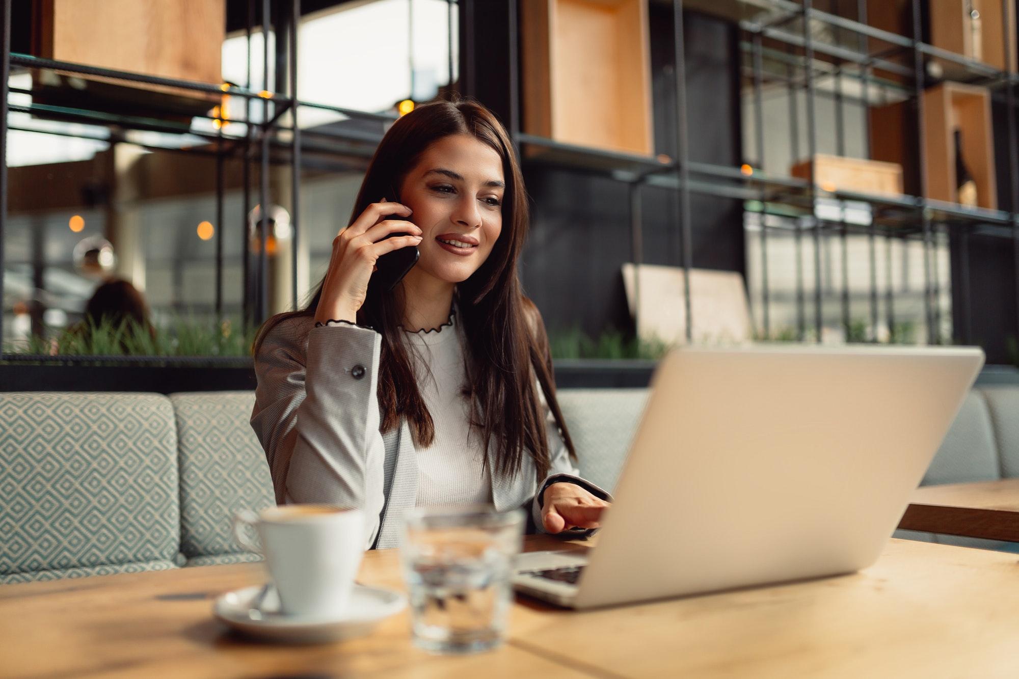 Businesswoman using technologies.